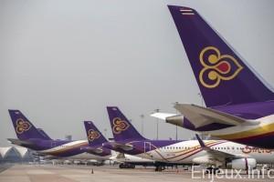 Thai Airways aircraft are parked on the tarmac at Bangkok's Suvarnabhumi International Airport