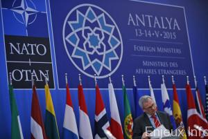 A delegate checks his documents prior to a session regarding the situation in Ukraine, during the NATO Foreign Ministers conference in Antalya, Turkey, Wednesday, May 13, 2015. The ministers have gathered for two days in the southern Turkish city to plot strategy amid the continued crisis in Ukraine and instability throughout the Middle East, including in neighboring Syria and Iraq. (AP Photo/Lefteris Pitarakis)