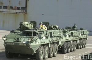 US, SOLDIERS, PREPARE, TO, DRIVE, OFF, STRYKER, ARMORED, VEHICLES, IN, KUWAITI, PORT