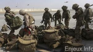 British soldiers arrive at Kandahar air base at the end of operations for U.S. Marines and British combat troops in Helmand